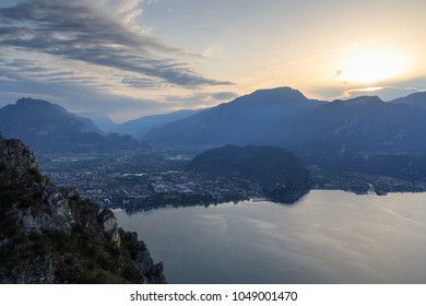 Riva del Garda town panorama at Lake Garda and mountains at sunrise in the morning, Italy