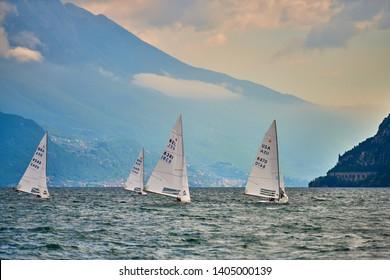 Riva del Garda,Lago di Garda ,Italy - 15 may 2019: Sailing boats on Garda Lake, beautiful Lake Garda surrounded by mountains