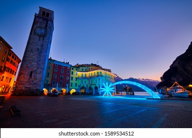 Riva del Garda,Lago di Garda ,Italy - 10 December 2019:Christmas lights adorning the city center and Riva del Garda Street, View of the beautiful Riva del Garda town by night,Italy