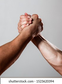 Rivalry, closeup of male arm wrestling. Muscular men measuring forces, arms. Hand wrestling, compete. Hands or arms of man. Muscular hand. Clasped arm wrestling. Two men arm wrestling.