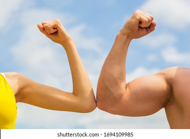 Rivalry, vs, challenge, strength comparison. Sporty man and woman. Muscular arm vs weak hand. Vs, fight hard. Competition, strength comparison. Rivalry concept. Hand, man arm fist Close-up