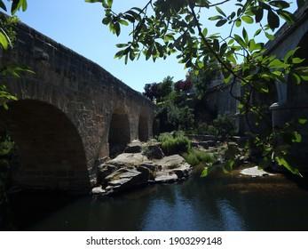 River Adaja, at Avila, full of green trees, at spring