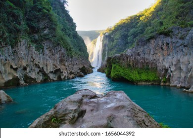 River and amazing crystalline blue water of Tamul waterfall in San Luis Potosí, Mexico