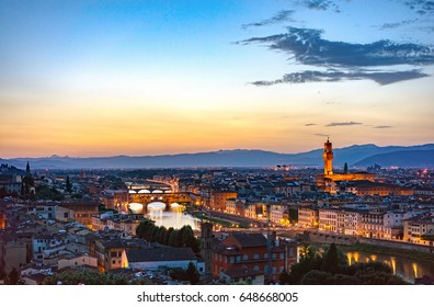 River Arno with bridge Ponte Vecchio and Palazzo Vecchio at night from Piazzale Michelangelo in Florence, Tuscany, Italy. Beautiful view Florence, Italy at night. Sunset in Florence, Italy.