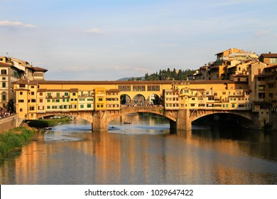 River Arno and stone bridge with shops built along it, Ponte Vecchio (Old Bridge), during the sunset, Florence, Tuscany, Italy.
