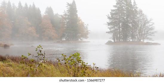 River autumn landscape in a frosty morning. Farnebofjarden national park in Sweden.