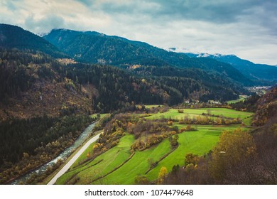 River Avvisio in Cavalese, aerial view, overcast moody autumnal day, focus on water