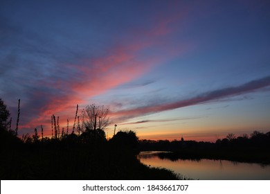 River bank after sunset with fine clouds