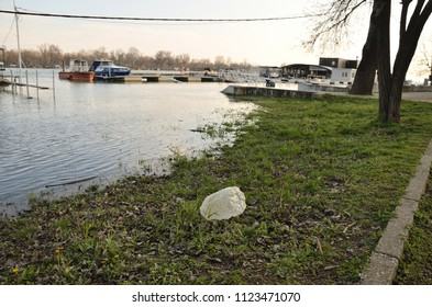 River bank with plastic litter after a flood