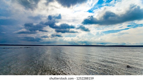 River banks against blue sky with white clouds in summer - Shutterstock ID 1252288159