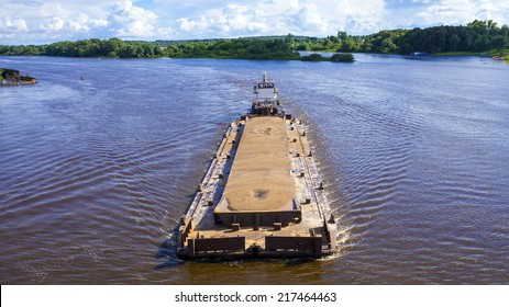 river barge loaded with sand