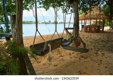 River beach with straw hut and swing in Kampot Cambodia