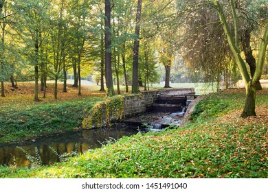 River bed with weir in autumn season