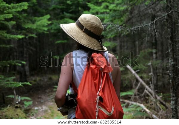 RIVER BENNETT, NOVA SCOTIA. AUGUST 10 2016. A woman walks through the Red Island Trail in Cape Breton