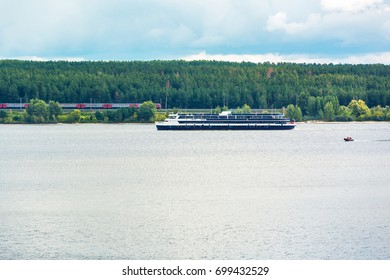 "The river Berd, Berd Bay, Novosibirsk oblast, Siberia, Russia - August 19, 2017: the Ship ""Viktor Gashkov"" floating on the river - Shutterstock ID 699432529"