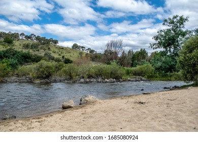 River with blue sky and clouds and hill