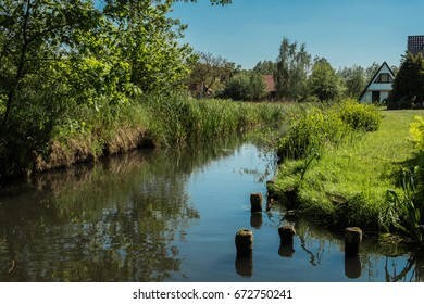 River with blue sky and reflections