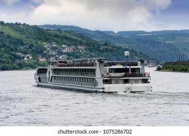 River boat cruising down the Rhine River near the village of Trechtingshausen in Germany.