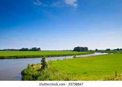 River and boat floating through the countryside grasslands