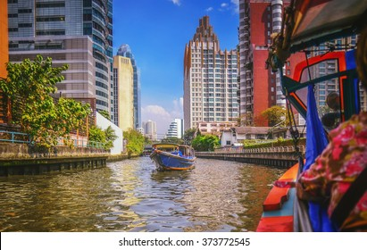 River boat transporting passengers and tourist down Chao Praya river , Bangkok , Thailand