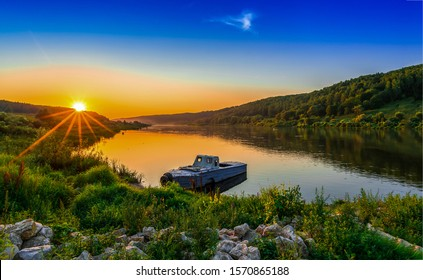 River boat at yellow sunset - Shutterstock ID 1570865188