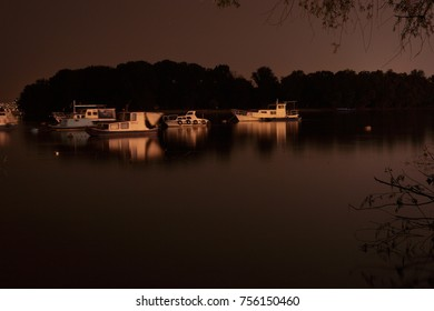 River boats on dark night ibefore the woods