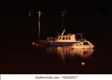 River boats on dark night in a marina