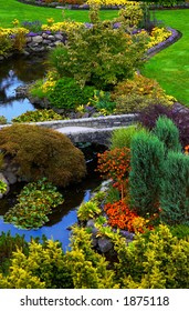 River, bridge, and flowers in Vancouver Queen Elizabeth Park. More with keyword group14h
