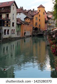 River called Thiou in downtown of Annecy in France and an ancient bridge
