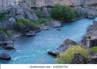 a river in the Canyon of Aksu Dzhabagly in the mountains of Alatau, the center of Asia, Kazakhstan. pure Running water of bluish color in the river