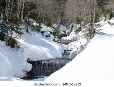 River with cascades during winter
