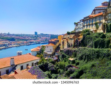 River in the city of Porto, Portugal. Tiled roofs and hanging gardens. Panorama. View from above.