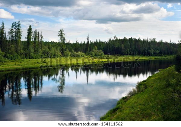 The river and clouds reflected in it, Sakha (Yakutia) Republic, Eastern Siberia, Russia