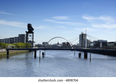 River Clyde at Pacific Quay, Glasgow with the Bells bridge in the foreground and the new Clyde arc behind it