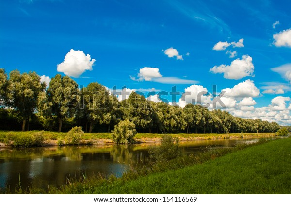 river at the countryside in flanders belgium