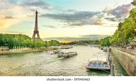 River cruise in Paris showing the Eiffel tower on sunset sky background.