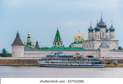 River cruise ship near the ramparts of the Orthodox monastery fortress with watchtowers , Makarievo, Volga, Russia