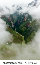 A river cuts through the valley of limestone and granite mountains in Ha Giang, Vietnam.