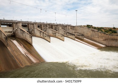 River Dam architecture with gate, lock and ramp. Water pouring through the water gates. Pa Sak Jolasid Dam in Lopburi, the biggest reservoir in Central Thailand
