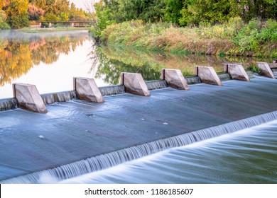 river diversion dams providing water for farming - Cache la Poudre River near WIndsor, Colorado, autumn scenery