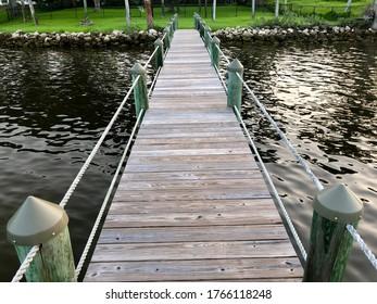 River Dock leading to grassy yard