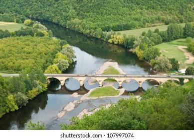 River Dordogne and stone arch bridge, Perigord, France