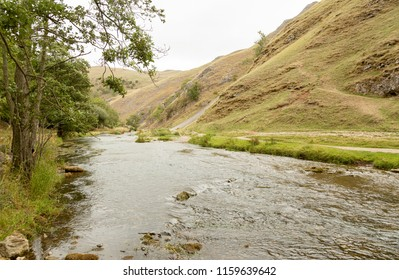 River Dove running through steep hills in Dovedale, Derbyshire UK