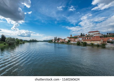 River Drava and old town Ptuj with mighty medieval castle on the hill, Slovenia