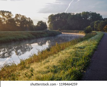 The river Dyle that flows from Mechelen to Muizen, during a misty sunrise. Belgium