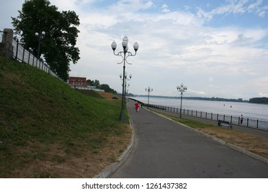 "River embankment after the rain. Embankment of the city ""Rybinsk"" on the Volga River."