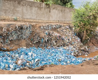 A river in Ethiopia is clogged with empty plastic bottles, environmental disaster.