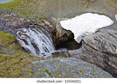 river falling down to a cave