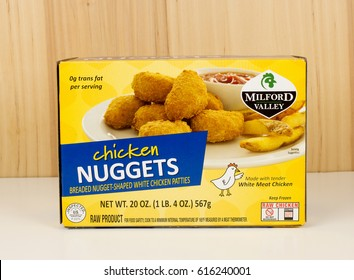 RIVER FALLS,WISCONSIN-APRIL 05,2017: A box of Milford Valley brand chicken nuggets with a wood background.