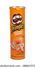 RIVER FALLS,WISCONSIN-APRIL19, 2014: A can of Pringles Cheddar Cheese chips. Pringles is a brand of potato snack chips owned by The Kellogg Company.